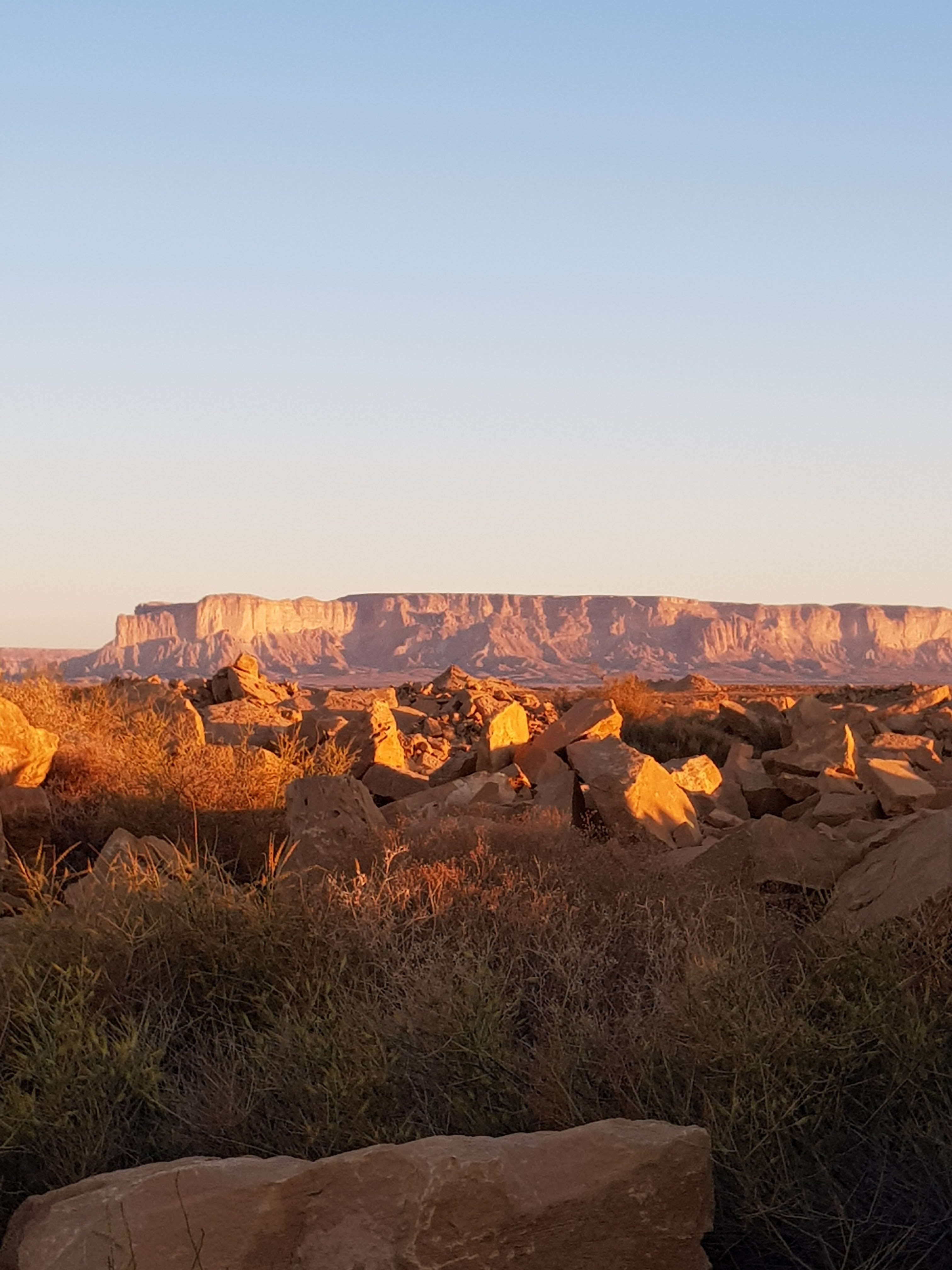 The sun on the escarpment in the morning from Al Barrah Fort
