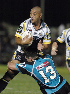 Paul Rauhihi of North Queensland cowboys in a tackle